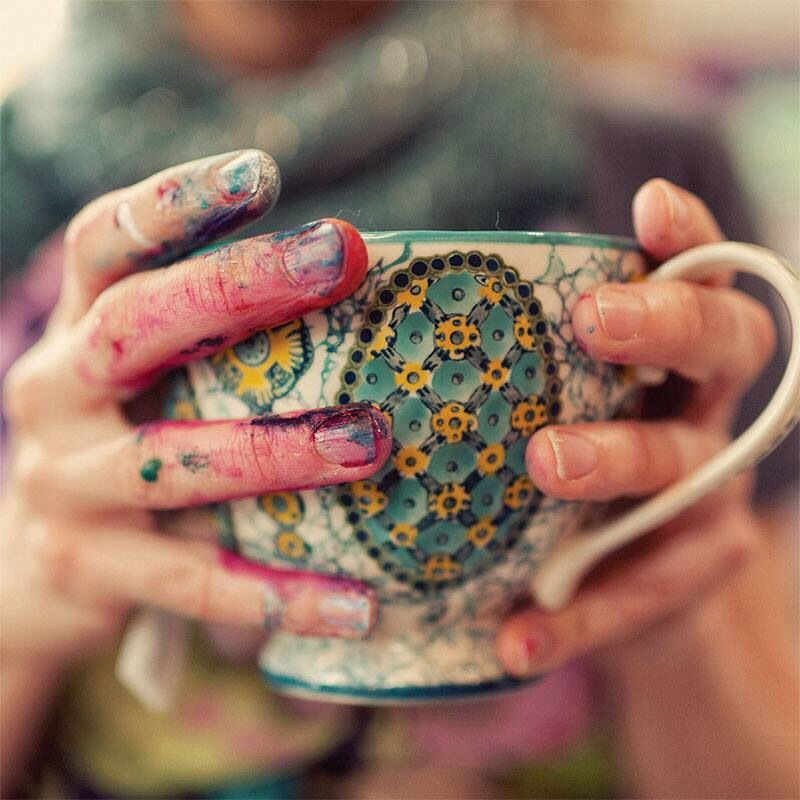 Live. Love. Laugh. Create - paint covered hands holding mug